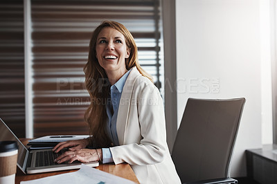 Buy stock photo Cropped shot of an attractive businesswoman looking thoughtful while working in her corporate office