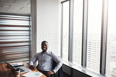 Buy stock photo High angle portrait of a handsome businessman working in his corporate office