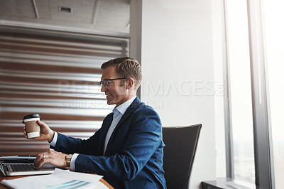 Buy stock photo Cropped shot of a handsome businessman working in his corporate office