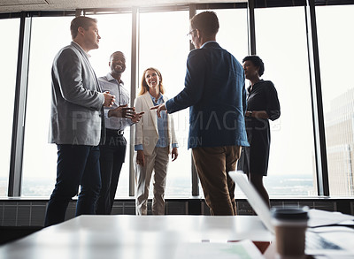 Buy stock photo Low angle shot of a group of corporate businesspeople meeting in their boardroom