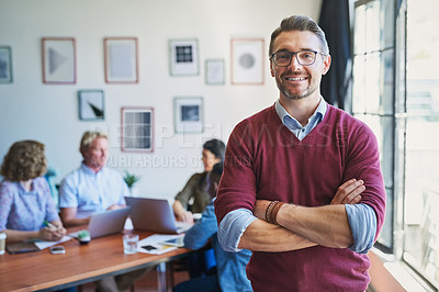 Buy stock photo Portrait of a confident mature man with his team in the background of a modern office