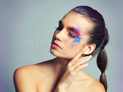 Buy stock photo Studio shot of an attractive young woman with brightly colored makeup against a gray background