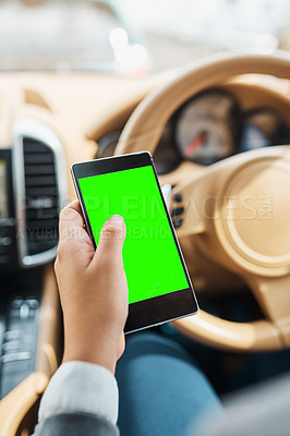 Buy stock photo Cropped shot of an unrecognizable woman using her cellphone while driving
