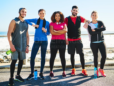 Buy stock photo Portrait of a cheerful young group of friends standing together before a fitness exercise outside during the day