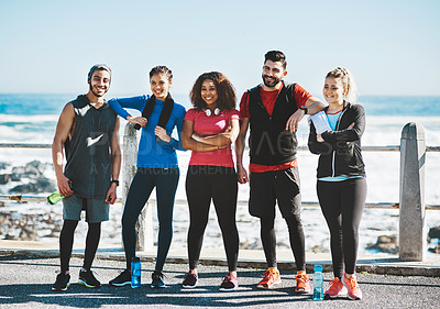 Buy stock photo Shot of a fitness group standing together while out for a run