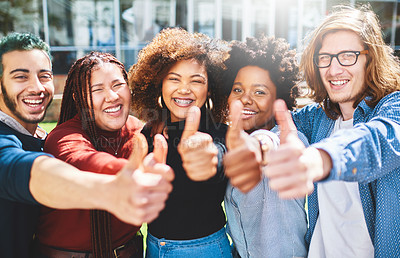 Buy stock photo Cropped portrait of a diverse group of college friends giving thumbs up while standing outside