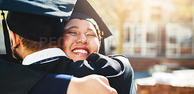 Buy stock photo Cropped shot of a young woman embracing her male friend after graduating