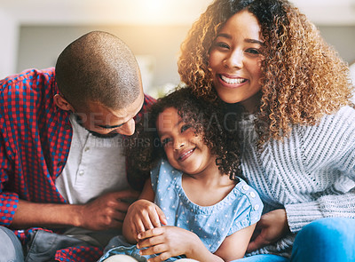 Buy stock photo Portrait of a happy young family of three spending quality time together at home
