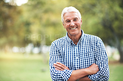 Buy stock photo Portrait of a happy and confident senior man standing in the park