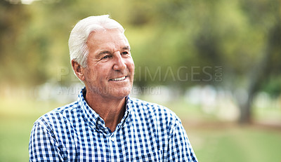 Buy stock photo Shot of a happy senior man spending a day in the park