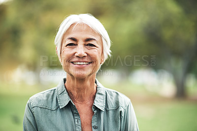 Buy stock photo Portrait of a happy and confident senior woman standing in the park