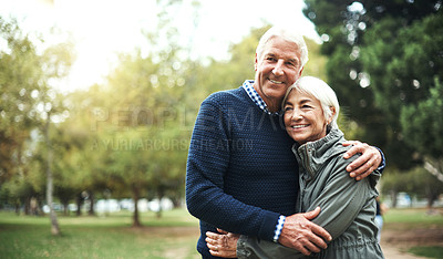 Buy stock photo Closeup shot of an affectionate couple spending the day at the park