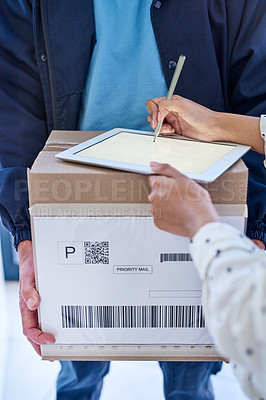 Buy stock photo Cropped shot of an unrecognizable delivery man getting a signature from a female customer for her order