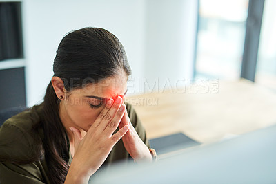 Buy stock photo Shot of a young businesswoman suffering with a headache in an office
