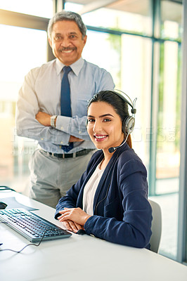Buy stock photo Cropped portrait of a female customer service representative and her supervisor at work in her office