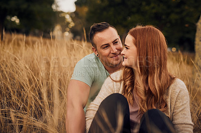 Buy stock photo Shot of an affectionate young couple in the countryside