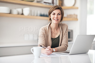 Buy stock photo Portrait of a mature woman writing notes while using a laptop at home