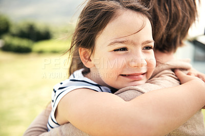 Buy stock photo Cropped shot of a young girl embracing her mother