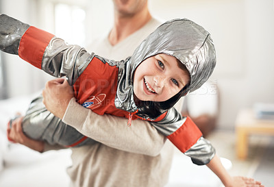 Buy stock photo Cropped portrait of an adorable little boy dressed as an astronaut while playing make believe with his dad