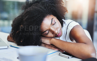 Buy stock photo Cropped shot of an attractive young businesswoman sleeping on her desk in her office