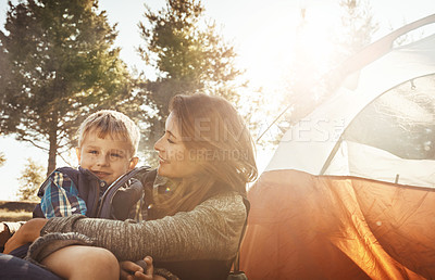 Buy stock photo Shot of a young beautiful mother and her son camping in the forest