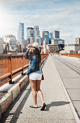 Buy stock photo Shot of a beautiful young woman out exploring the city