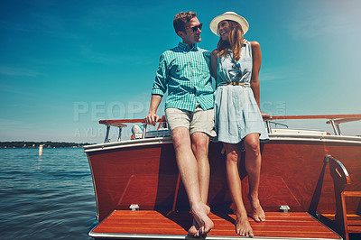 Buy stock photo Shot of a young couple spending time together on a yacht