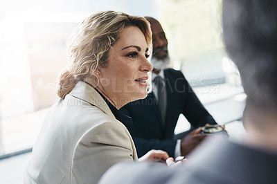 Buy stock photo Shot of a businesswoman having a meeting with her colleagues in an office