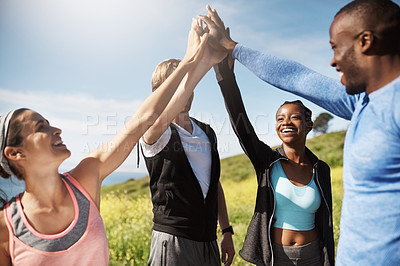 Buy stock photo Cropped shot of a fitness group high-fiving after a workout