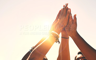 Buy stock photo Cropped shot of a group of unrecognizable people high-fiving