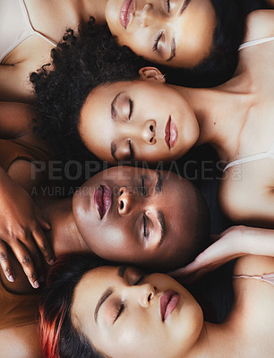 Buy stock photo High angle shot of a group of beautiful young women lying next to each other