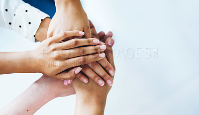 Buy stock photo Closeup shot of a group of unrecognizable people joining their hands together in a huddle