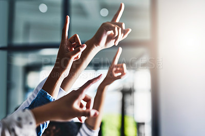 Buy stock photo Cropped shot of a group of unrecognizable people raising their hands to ask a question