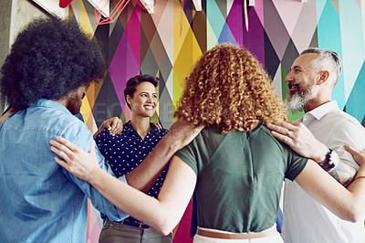 Buy stock photo Shot of a group of designers standing in a huddle in an office