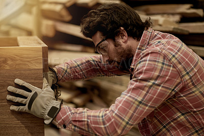 Buy stock photo Cropped shot of young carpenters working in their workshop