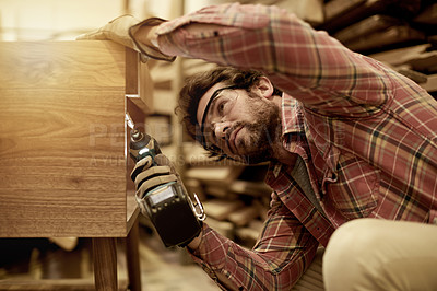 Buy stock photo Cropped shot of a carpenter putting together a wood piece