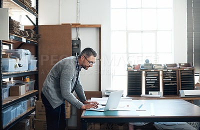 Buy stock photo Shot of a male designer working in the workshop