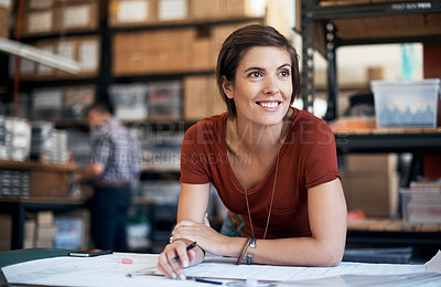 Buy stock photo Shot of a woman working on a plan in a workshop
