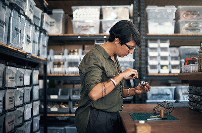 Buy stock photo Shot of a woman manufacturing something in a workshop