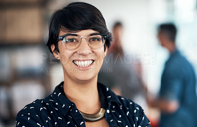 Buy stock photo Portrait of a confident woman in a workshop with her colleagues working in the background