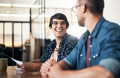 Buy stock photo Shot of a man and woman having a meeting in a workshop