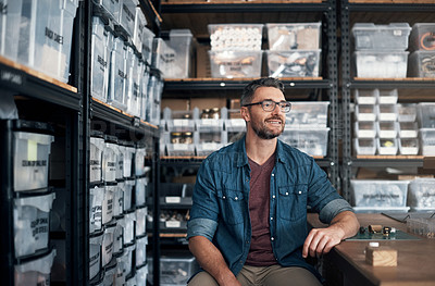 Buy stock photo Shot of a mature man sitting in a workshop