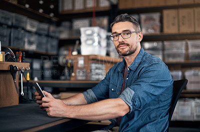 Buy stock photo Portrait of a mature man using a digital tablet in a workshop