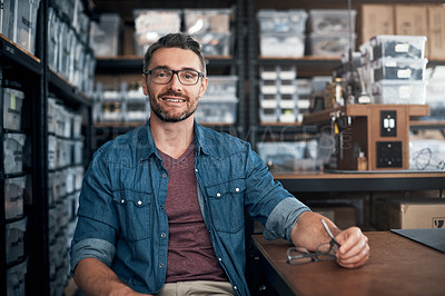 Buy stock photo Portrait of a mature man sitting in a workshop