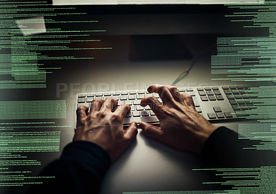 Buy stock photo Cropped shot of an unrecognizable hacker cracking a computer code in the dark