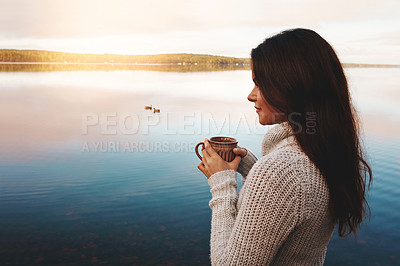 Buy stock photo Cropped shot of an attractive young woman spending time alone by the lake