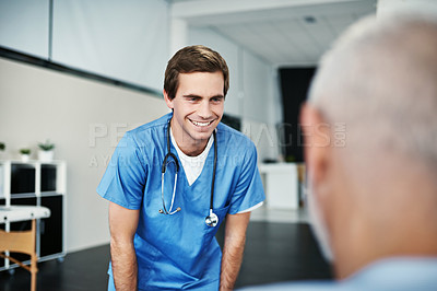 Buy stock photo Shot of a male nurse caring for a senior patient