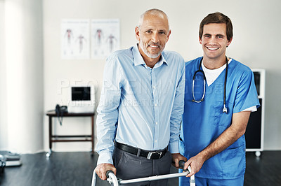 Buy stock photo Portrait of a male nurse assisting a senior patient with a walker