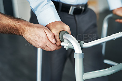 Buy stock photo Closeup shot of a person assisting a man with a walker
