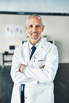 Buy stock photo Portrait of a mature doctor standing in a hospital